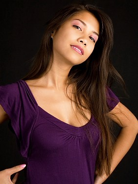 Beautiful Brunette Asian Lady Posing in a Purple Dress